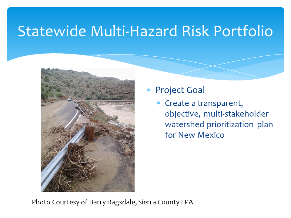 A PowerPoint slide showing flood damage in Sierra County, New Mexico and the overall goal of the Statewide Multi-Hazard Risk Portfolio