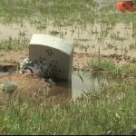 Image of sunken headstone in Loving, NM cemetery from KOB News.