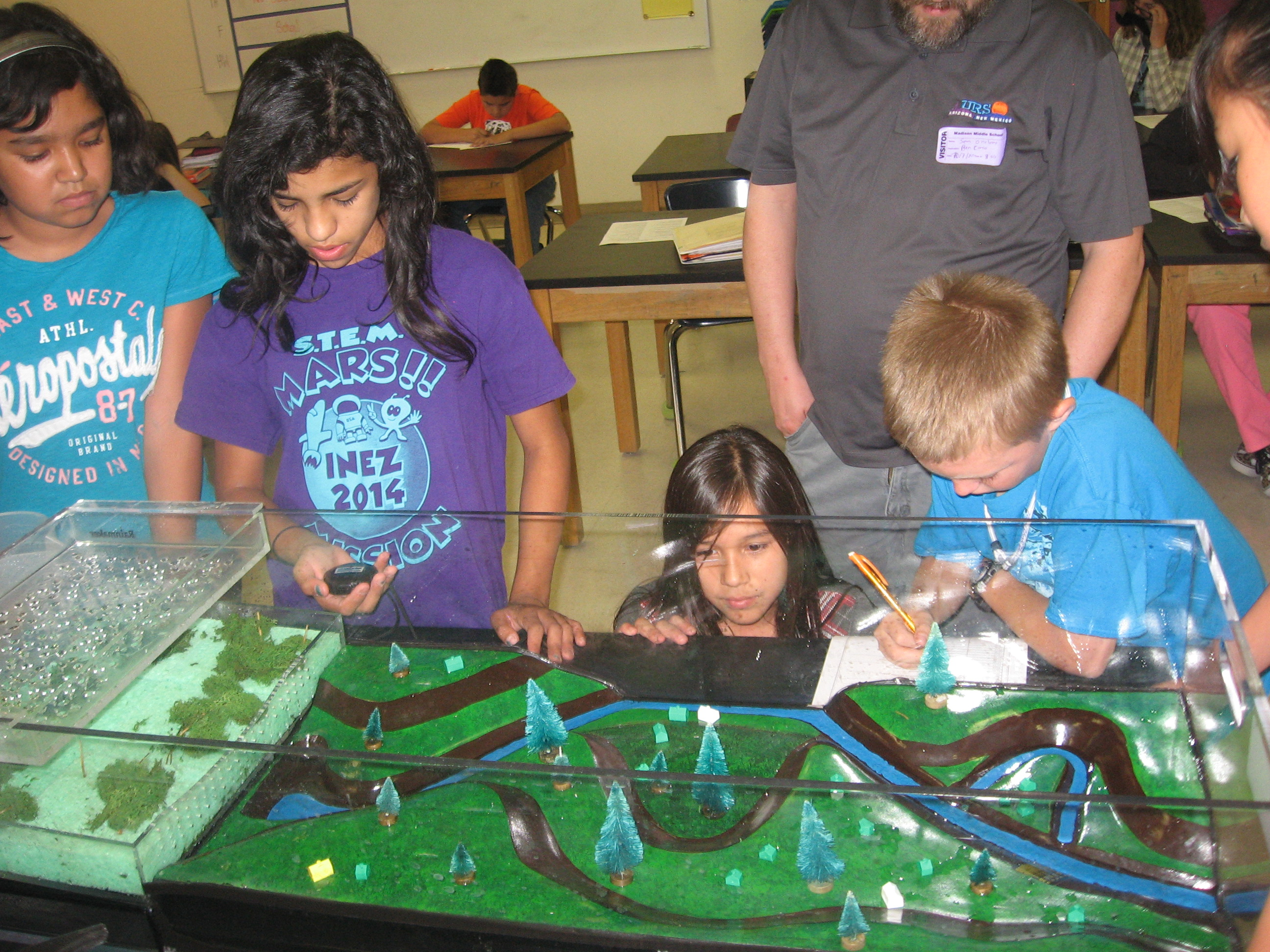 Students using the Wards Scientific floodplain simulator