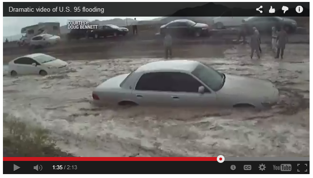 A picture of two cars floating down the median along interstate 25 near Las Vegas, Nevada.