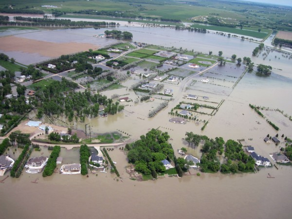 An aerial picture of flooded buildings along the Missouri River. Image Credit US Army Corp of Engineers.