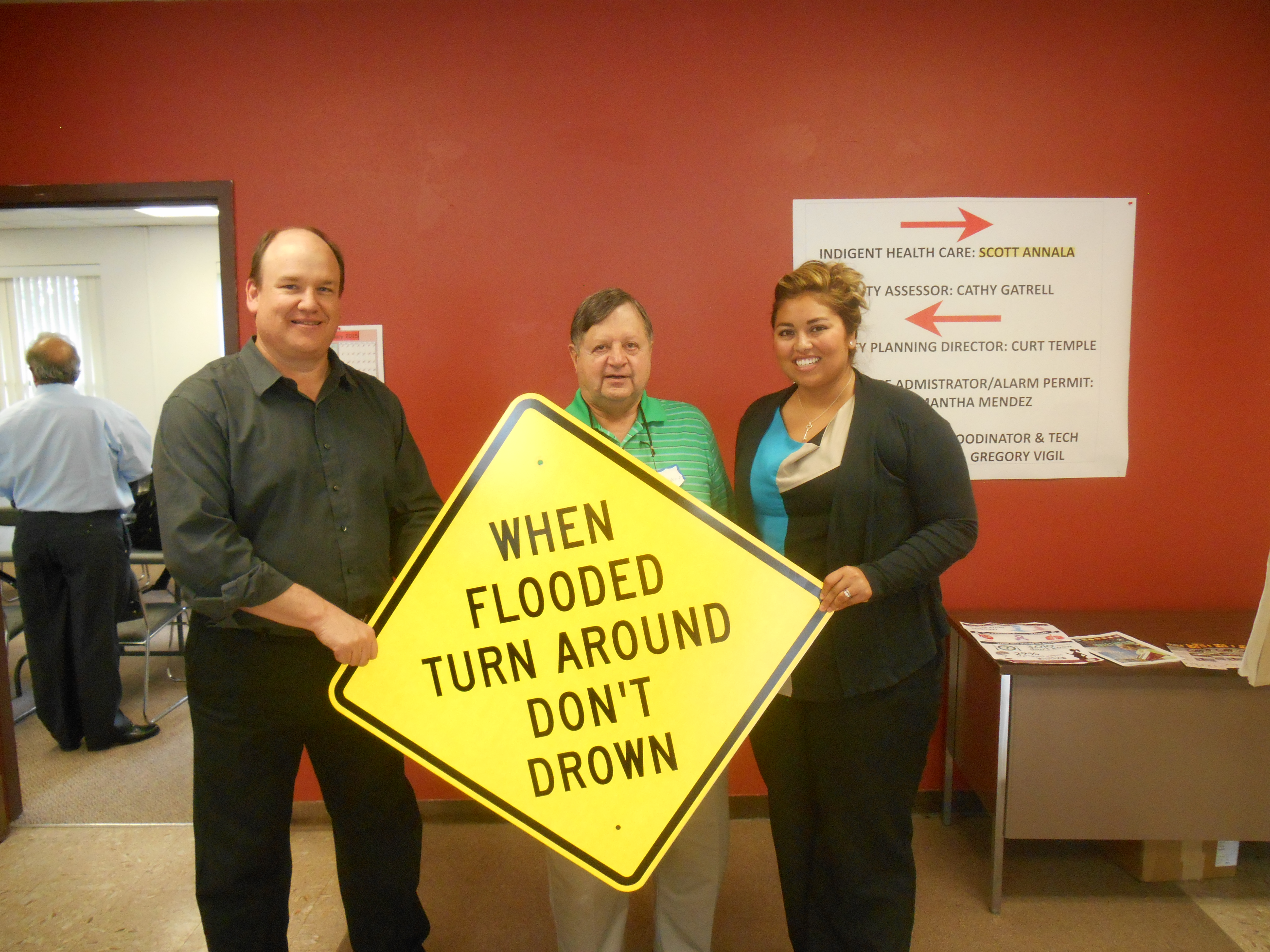 Curt Temple receiving the first Turn Around Don't Drown signs from Bill Borthwick in Lincoln County.